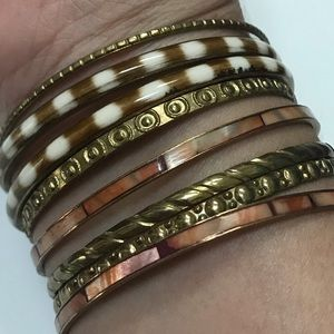 """Set of 8 assorted gold bangles 2.5"""" wide"""